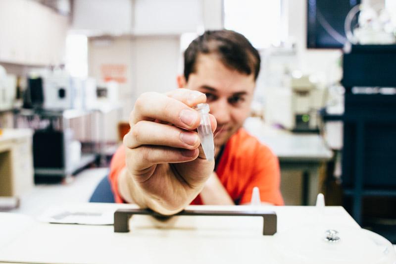 Joseph holding a test tube