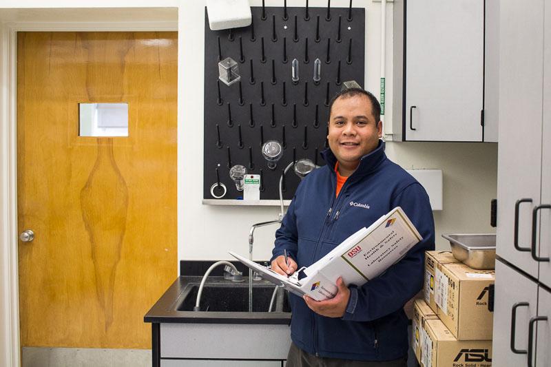 Matt inspecting the laboratory to meet standards