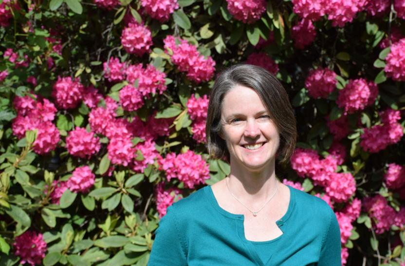 Leanne Giordono with pink flowers