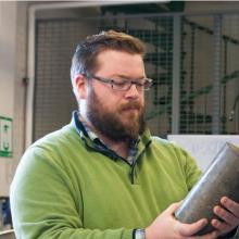 Adams holding a concrete sample